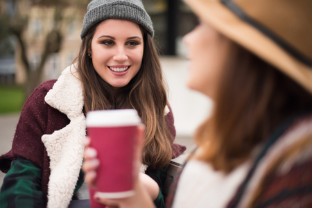 autumn young: Couple of friends with hot drink on winter Stock Photo