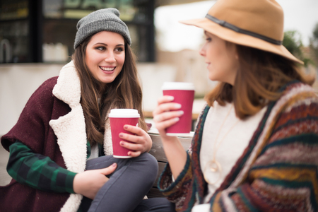 women coffee: Couple of friends with hot drink on winter Stock Photo