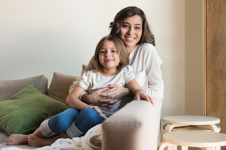 mother love: Mother and daughter relaxing together in the living room