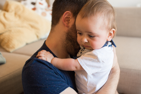 Young father taking care of crying baby