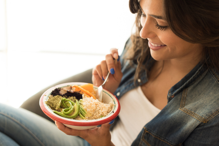 Woman eating a vegan bowl of superfoods Stock Photo