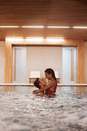 Couple in love at luxury Hotel Spa and pool Stock Photo
