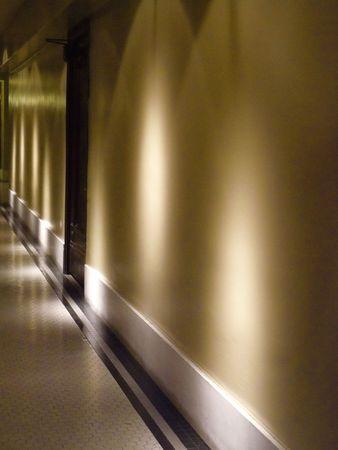 dramatically: A dramatically lit, quiet hallway