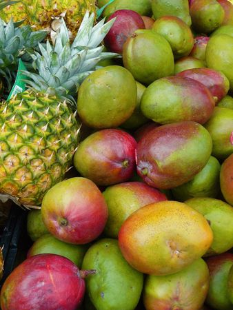 Pineapple and angoes and lemons displayed for sale at a farmers market Stok Fotoğraf