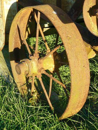 Wheel of Antique Threshing Machine Stock Photo - 3798416