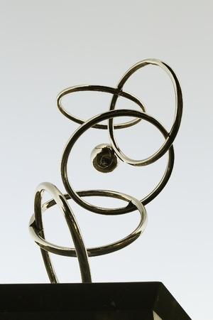 Artistic stainless metal rings, shot taken against gray sky. Stock Photo - 11958422