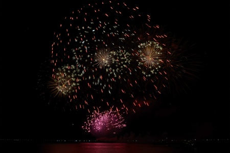 colorful huge fireworks display and reflection. photo