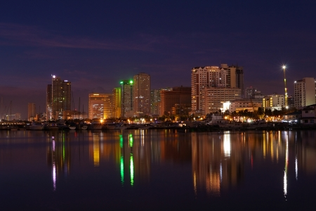 vibrant manila bay city nightscape and building reflections  Stock Photo