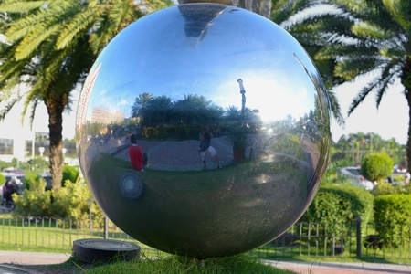 closeup image of a metalic stainless ball  in a park  photo