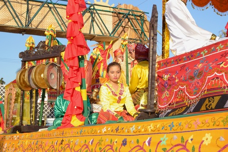MANILA, PHILIPPINES - APR  14  parade contestant in her cultural dress pauses during Aliwan Fiesta, which is the biggest annual national festival competition on April 14, 2012 in Manila Philippines