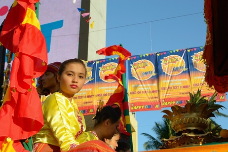 MANILA, PHILIPPINES - APR  14  parade contestant in her cultural dress pauses during Aliwan Fiesta, which is the biggest annual national festival competition on April 14, 2012 in Manila Philippines  Stock Photo - 13315919