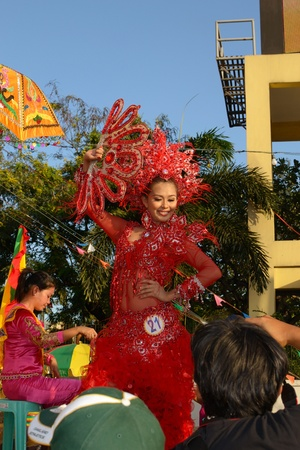 contestant: MANILA, PHILIPPINES - APR  14  pageant contestant in her cultural dress pauses during Aliwan Fiesta, which is the biggest annual national festival competition on April 14, 2012 in Manila Philippines