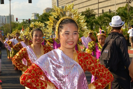MANILA, PHILIPPINES - APR  14  street dancers enjoying parade during Aliwan Fiesta, which is the biggest annual national festival competition on April 14, 2012 in Manila Philippines  Stock Photo - 13315966