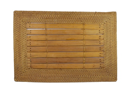placemat: closeup image of a bamboo placemat with wooven ratan edge  Stock Photo