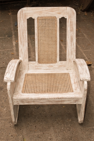 old wooden caned chair restored and repainted.   photo