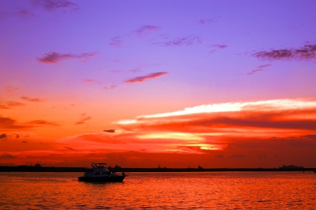 dramatic cool and warm colored sunset at manila bay philippines  Stock Photo