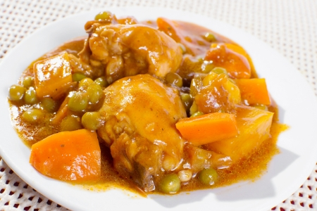 stew: chicken stew with potatoes, carrots, green peas in tomato sauce