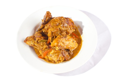 plate of roasted chicken cooked in sweet spicy barbecue sauce photo