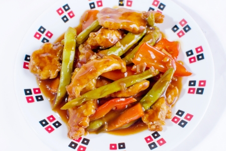 stir fry fried chicken strips with green beans, bell pepper, and carrots in sweet and sour sauce  Asian delicacy  photo