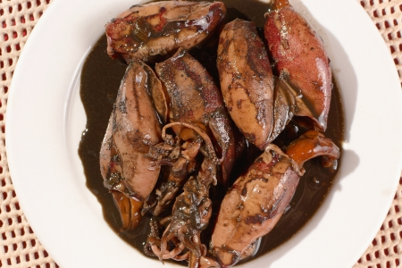 soysauce: plate of sauteed small squid stewed in soy sauce and vinegar, top view angle