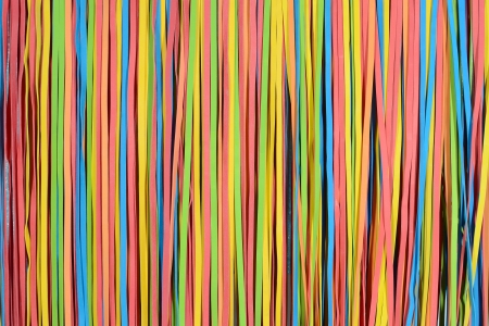 rubber band: vibrant small rubber strips arranged in vertical pattern, horizontal frame
