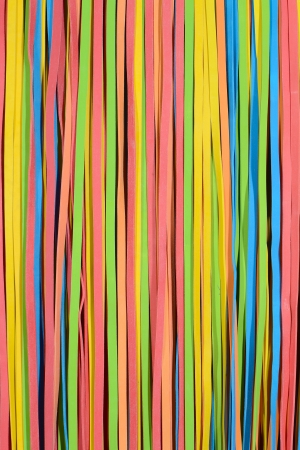 rubberband: vibrant small rubber strips arranged in vertical pattern, vertical frame