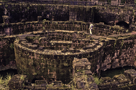 manila: ruins of thick circular wall at baluarte de san diego intramuros manila.