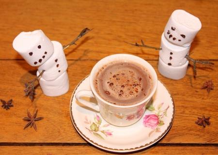warming: Hot warming cocoa and marshmallow snowmen