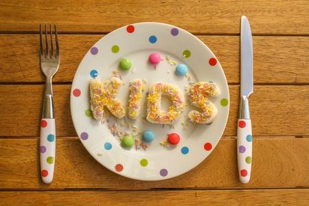 spotty: The word KIDS written in sprinkles on a spotty plate