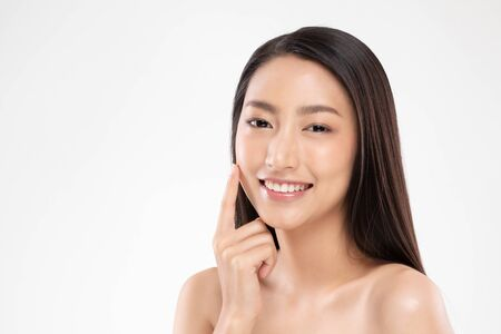 Beautiful Asian woman touching soft cheek smile with clean and fresh skin Happiness and cheerful with positive emotional,isolated on white background,Beauty and Cosmetics Concept