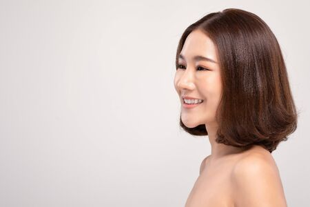 Side view of Beautiful Asian woman smile with clean and fresh skin Happiness and cheerful with positive emotional,isolated on white background,Beauty and Cosmetics Concept