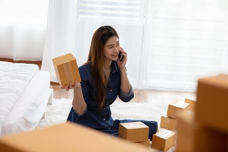 SME entrepreneur of Young Asian women working with laptop for Online shopping at home and talking with customer to delivery order,Own Business Start up for Business Online and Online shopping