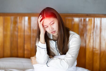 Asian young Woman have a Migraine and headache after wake up in the morning,Healthcare Concept