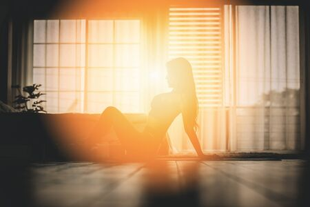 silhouette Athletic woman practice yoga stretching pose for stretching muscle for warm up with meditation smile after wake up in the morning Feeling so comfortable and relax,Healthcare Concept