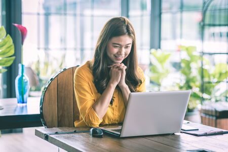 Beautiful Attractive Asian woman working with computer laptop and thinking to get ideas and requirement in Business startup feeling so happiness,Business Startup Concept Foto de archivo