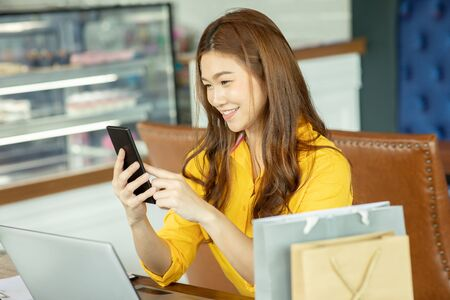 Beautiful Attractive Asian woman using smartphone for shopping online transform to online payment feeling so enjoy and happiness,Shopping Technology concept Foto de archivo
