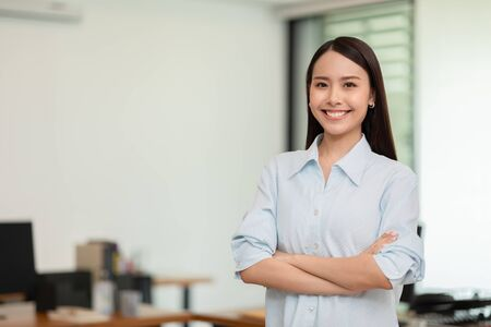 Asian business women leader standing smile cross arm and confidence at Co-Working space,Business Startup Concept Stock Photo