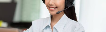 Banner of close up Happy Telemarketer Asian woman wear headset smile and customer support on phone call service