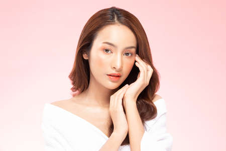 Beautiful Asian woman smile with clean and fresh skin Happiness and cheerful with positive emotional,isolated on pink background,Beauty Cosmetics and spa Treatment Concept