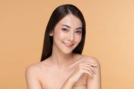 Side view of Beautiful Asian woman smile with clean and fresh skin Happiness and cheerful with positive emotional,isolated on Beige background,Beauty and Cosmetics Concept