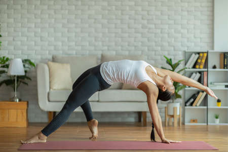 Calm of Attractive asian Woman practice yoga Wild thinG to breathing meditation at home Feeling so comfortable and relax,Wellness Healthcare Concept