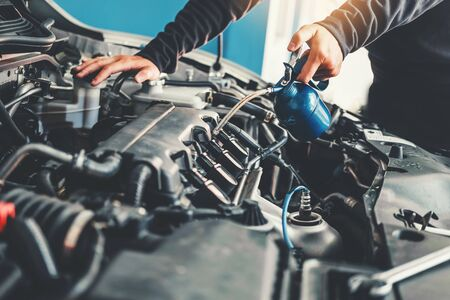 Technician Hands of car mechanic working in auto repair Service and Maintenance car