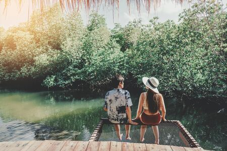 Couple relaxing in mangrove forest Lagoon vacation time Stock Photo