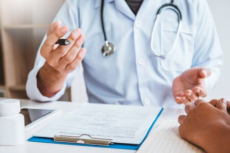Doctors and patients Consulting about Treatment guidelines at office