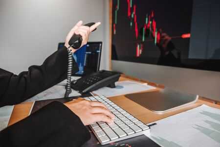Business woman deal Investment stock market discussing graph stock market trading Stock traders concept.