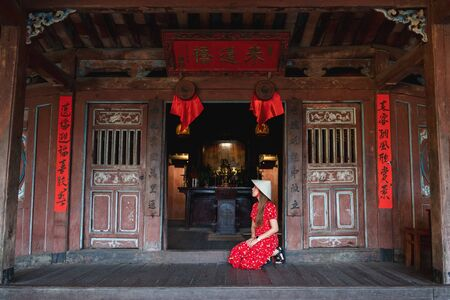 Travel woman with Japanese Covered Bridge,  in Hoi An, Vietnam