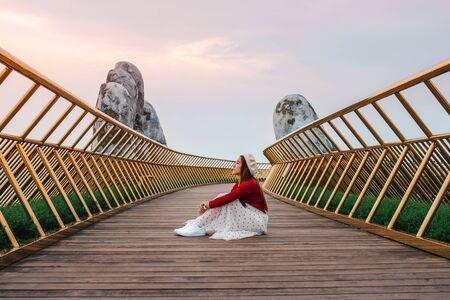 Travel woman at Golden Bridge in Ba Na Hills ,Danang Vietnam