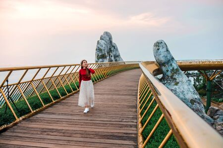 Travel woman at Golden Bridge in Ba Na Hills ,Danang Vietnam