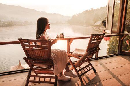 Asian women drinking Tea Sunrise at Lee wine Rak Thai, Chinese settlement, Mae Hong Son, Thailand