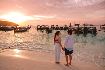 Couple relaxing beautiful sunset on Koh Lipe Beach Thailand ,Summer vacation Stock Photo